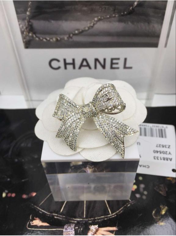 Золотая Брошка Chanel бантик золотые камни