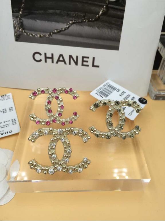 Золотая брошка Chanel розовые камни