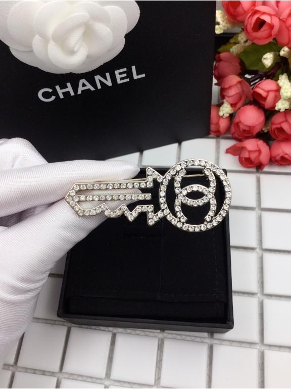 Золотая брошка Chanel ключ
