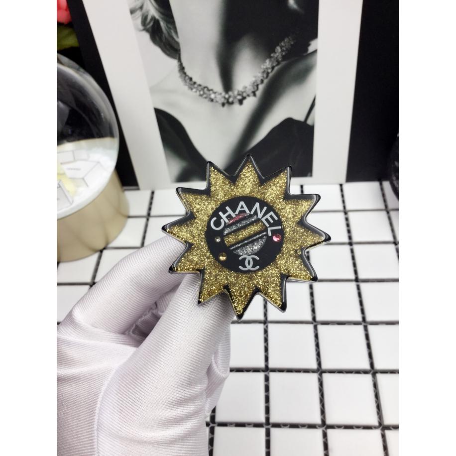 Брошка Chanel желтая звезда