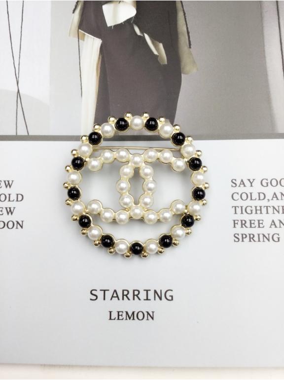 Золотая Брошка Chanel круг бело - черные жемчужинки