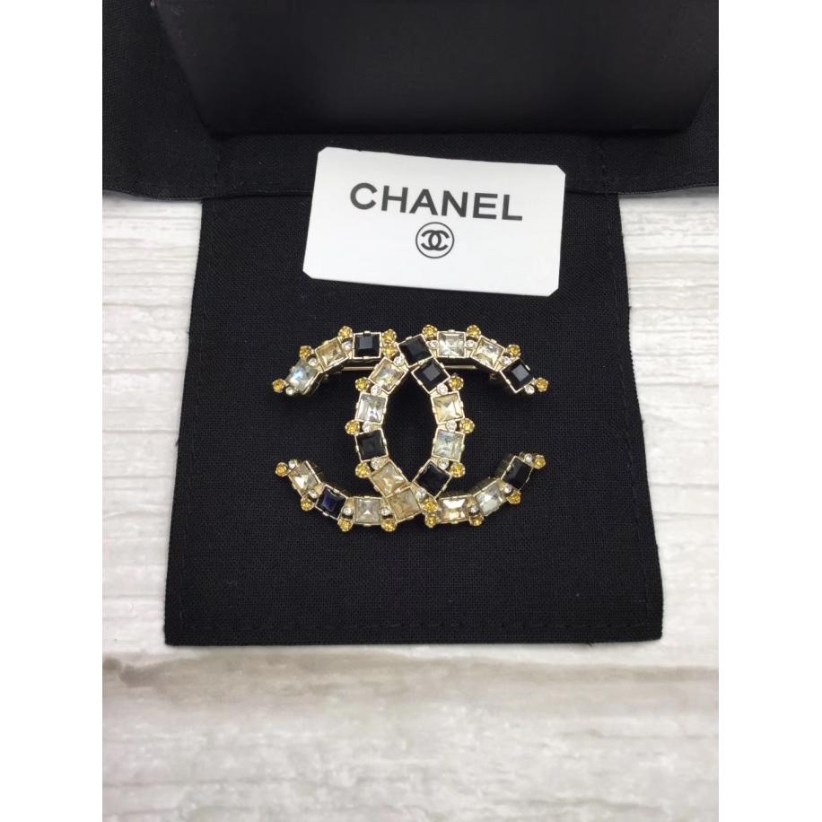 Золотая Брошка Chanel значок бело - черные камни