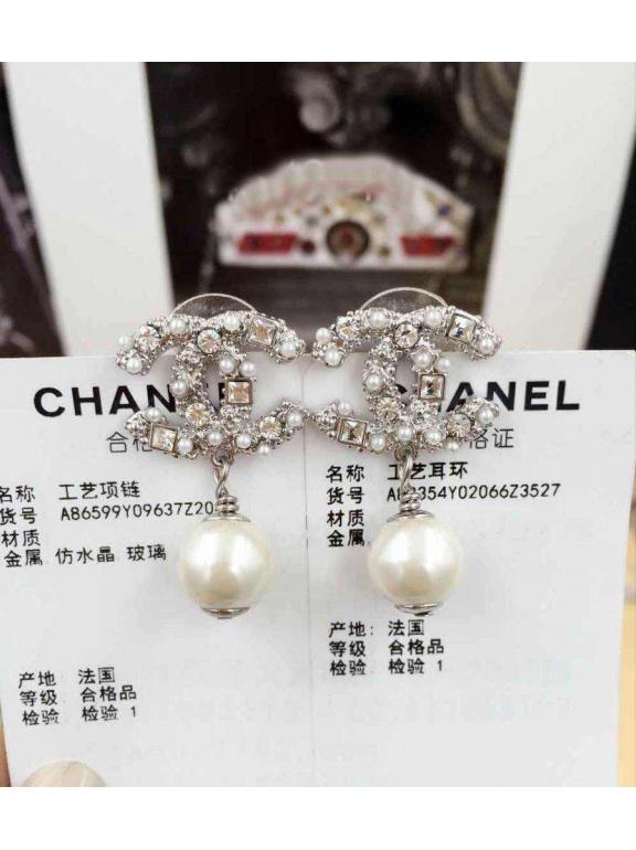 Белые серьги Chanel жемчужинки камни
